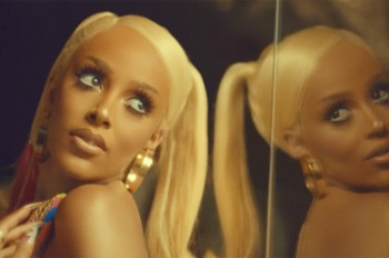 Doja Cat Serves Up '70s Goddess Vibes in Flirtatious 'Say So' Video: Watch