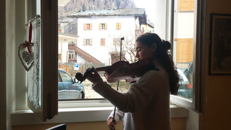 <p>Marta Cinelli, playing the viola in the window in Milan. </p>