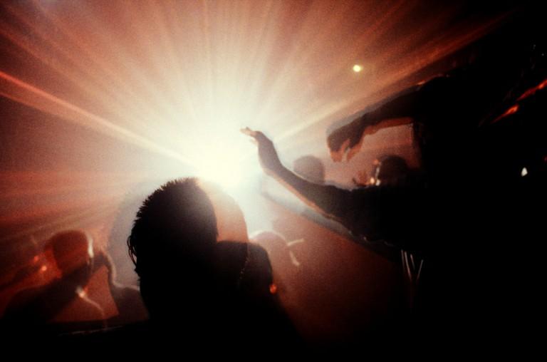 Crowd with lights Megatripolis London UK 1990's