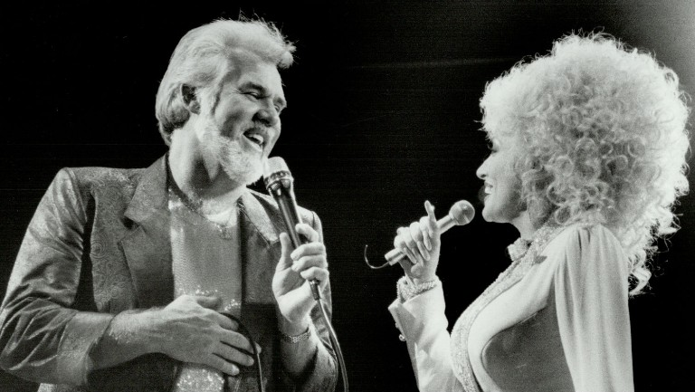 <p>Kenny Rogers and Dolly Parton perform together at Toronto's Maple Leaf Gardens in 1996.</p>