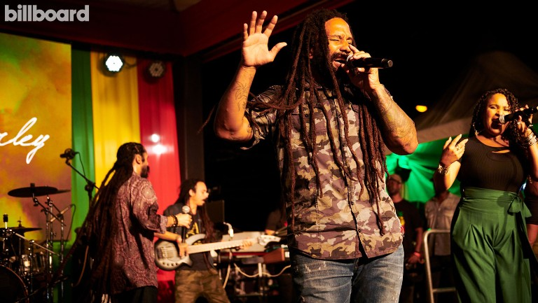<p>Ky-Mani (foreground) and Damian (far left) Marley performed at Bob Marley's 75th Earthsong Celebration Redemption at the Bob Marley Museum in Kingston, Jamaica, on Feb.6.</p>