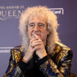 Queen's Brian May Comments on Eric Clapton's 'Different Views,' Calls Anti-Vaxxers 'Fruitcakes' thumbnail