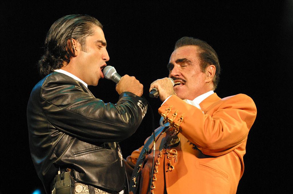 Alejandro & Vicente Fernandez Celebrate Father's Day With 'Menti' Video & Rare Photos
