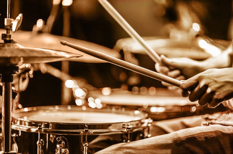drummer-playing-drums-on-stage-billboard-1548-1596646450