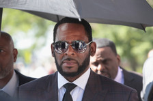 R. Kelly's Manager Charged With Placing Threatening Call to Theater Screening Abuse Documentary