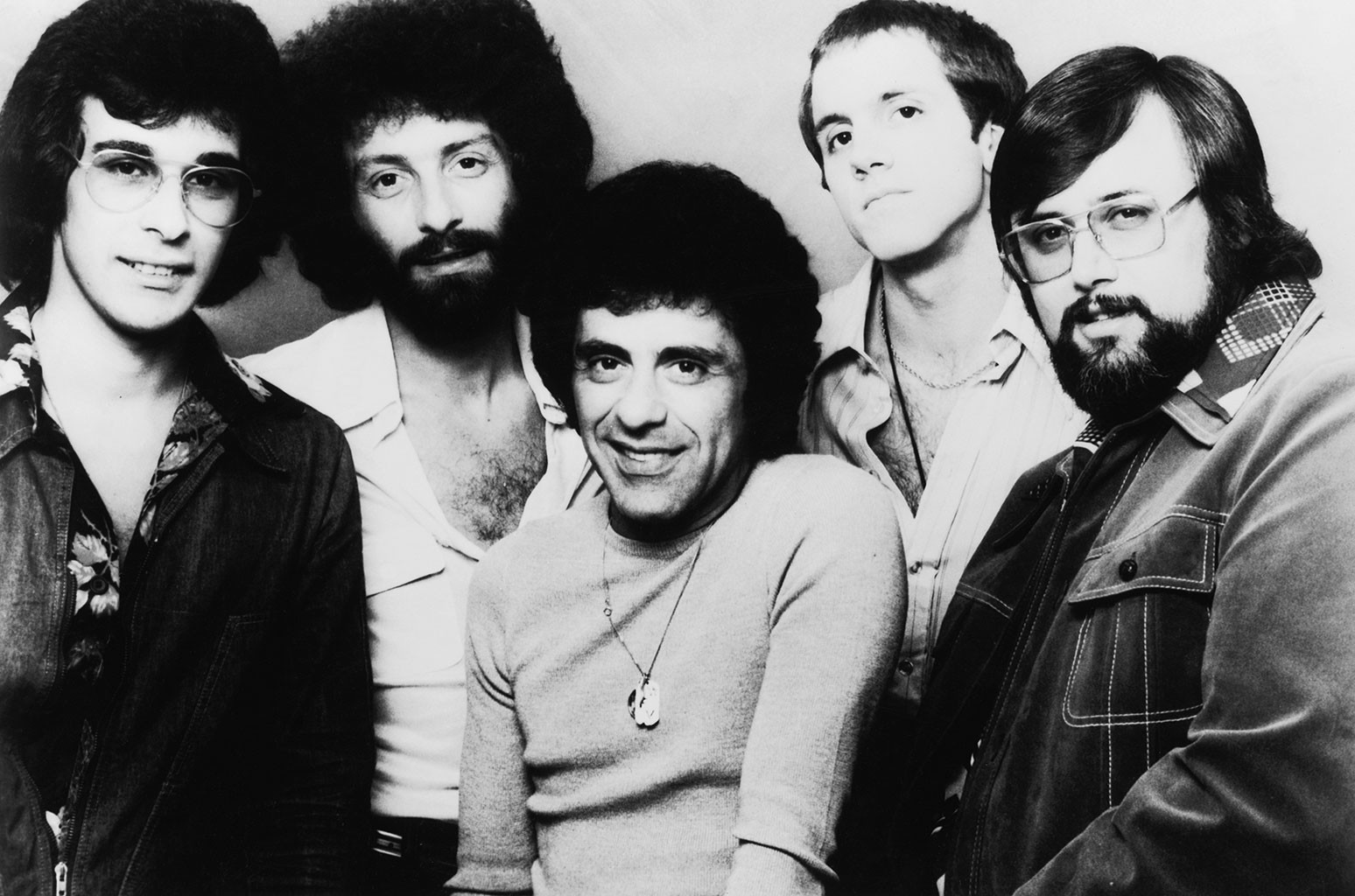 Frankie Valli (centre) with a late line up of The Four Seasons vocal group, circa 1975.