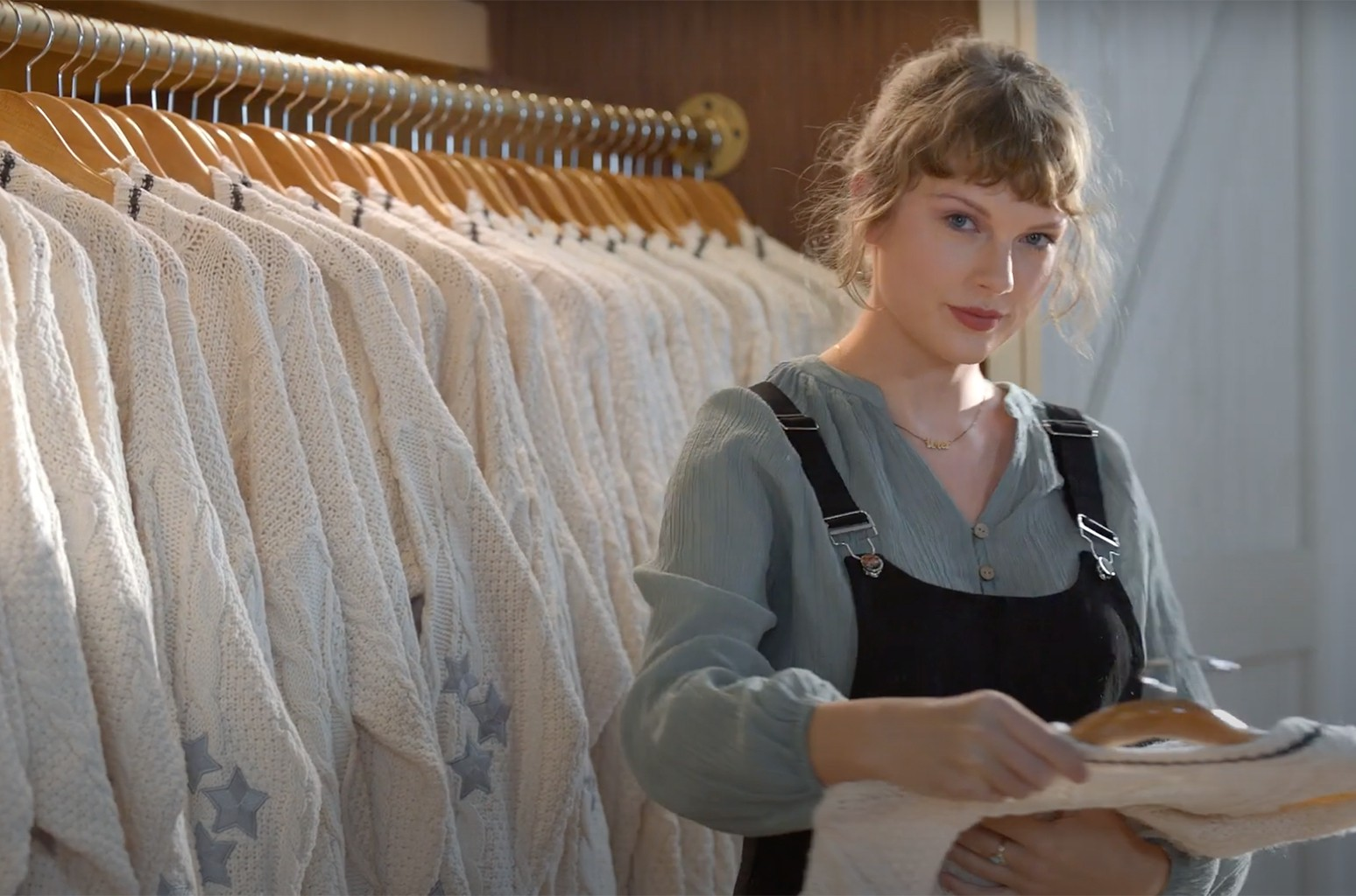 Taylor Swift Shows Off Closet Full Of Folklore Cardigans In New Capital One Ad Billboard