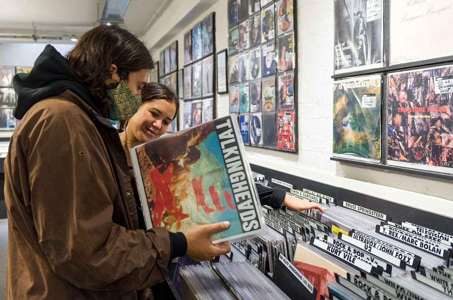 young people buying vinyl records record store day