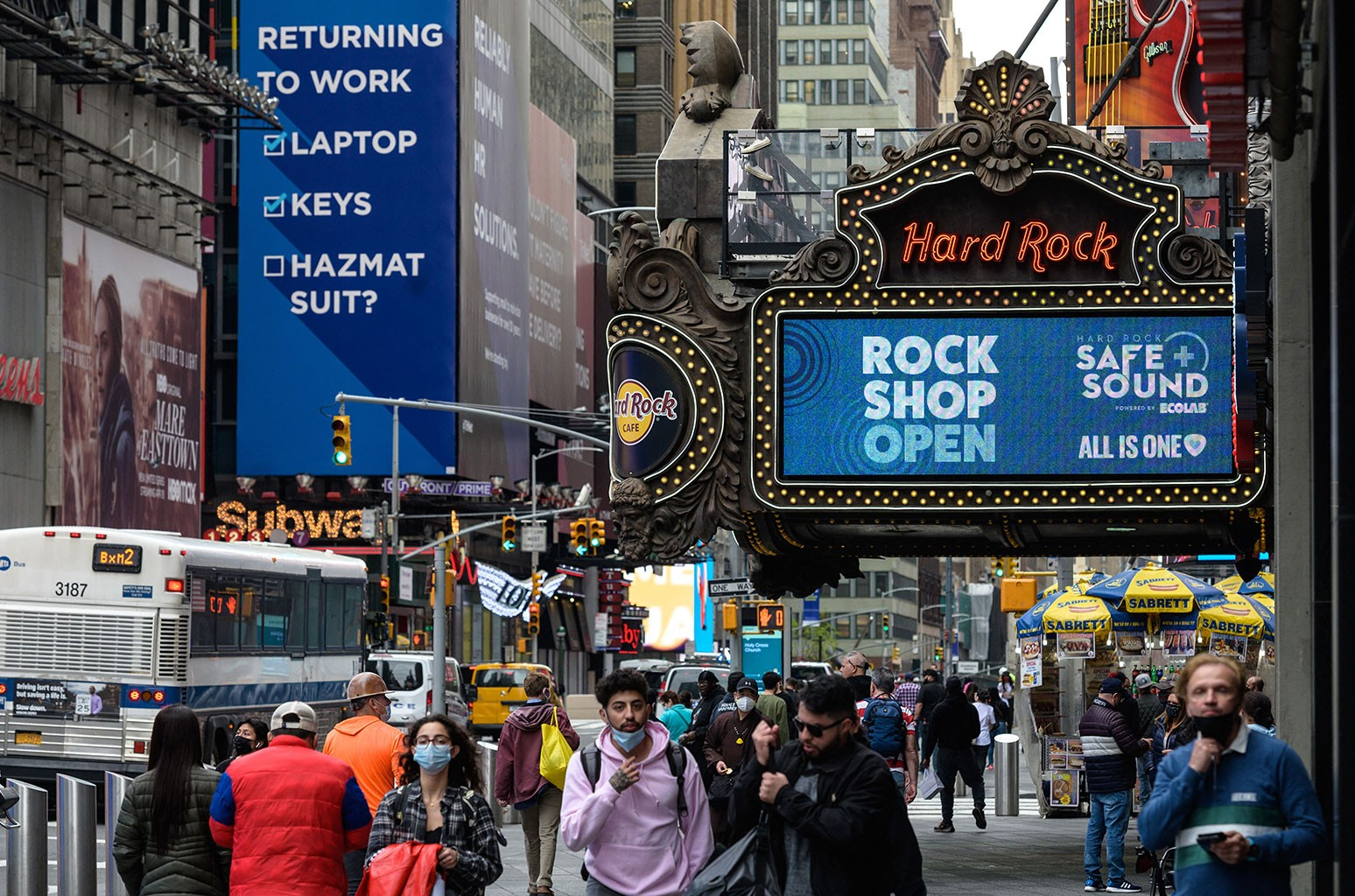 People walk past the Hard Rock Cafe on May 3, 2021 in New York City.