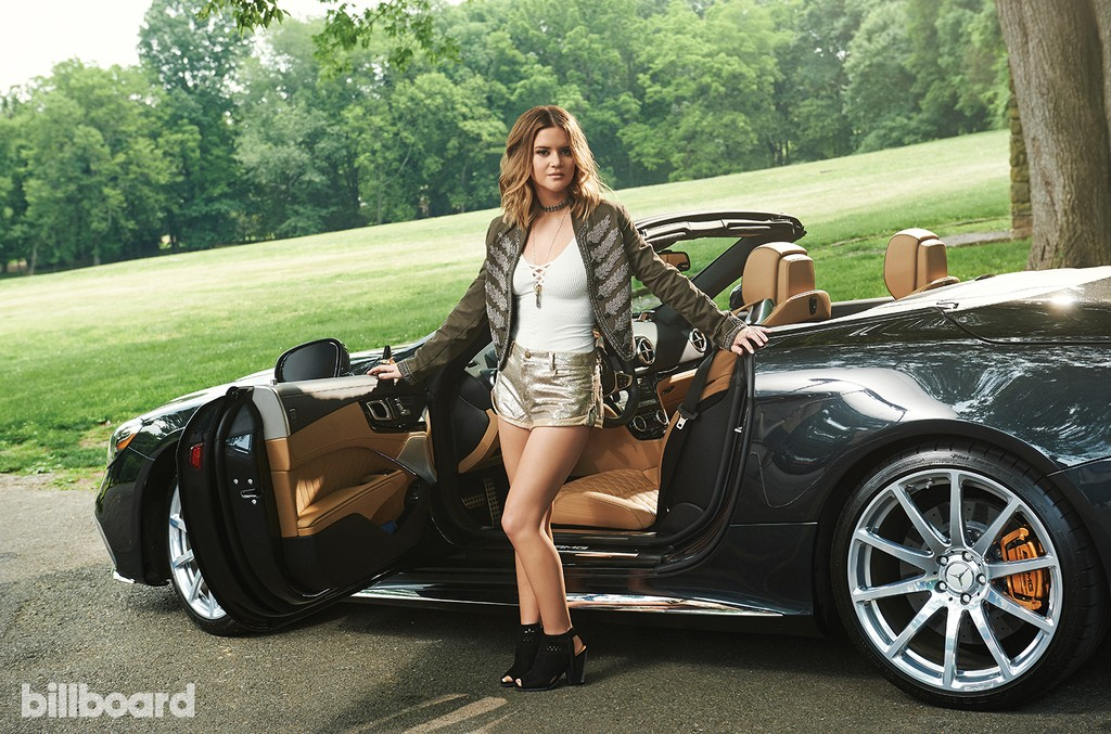 """The two-seater SL roadster goes from 0 to 60 mph in 3.9 seconds. Not that the singer needs the speed: """"I drive to clear my mind, like many people do,"""" says Morris, photographed  May 25 at Percy Warner Park in Nashville."""