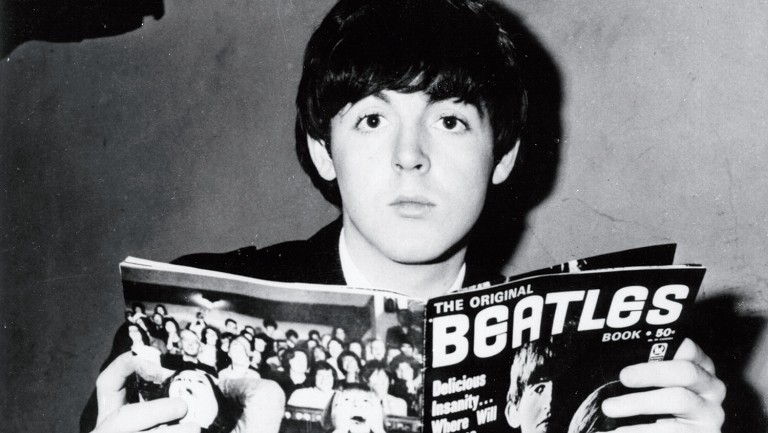 <p>McCartney with a fanzine at the height of Beatlemania in 1964.</p>