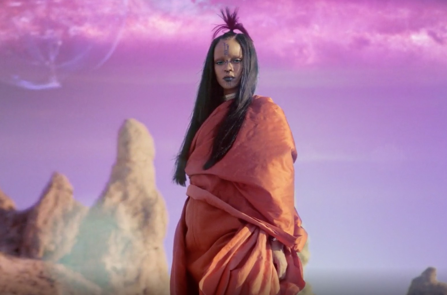 "Rihanna in the video for ""Sledgehammer."""