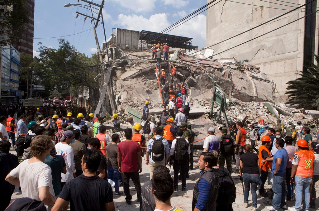 Volunteers and first responders look for survivors in a collapsed building after an earthquake struck Mexico City on Sept. 19, 2017.