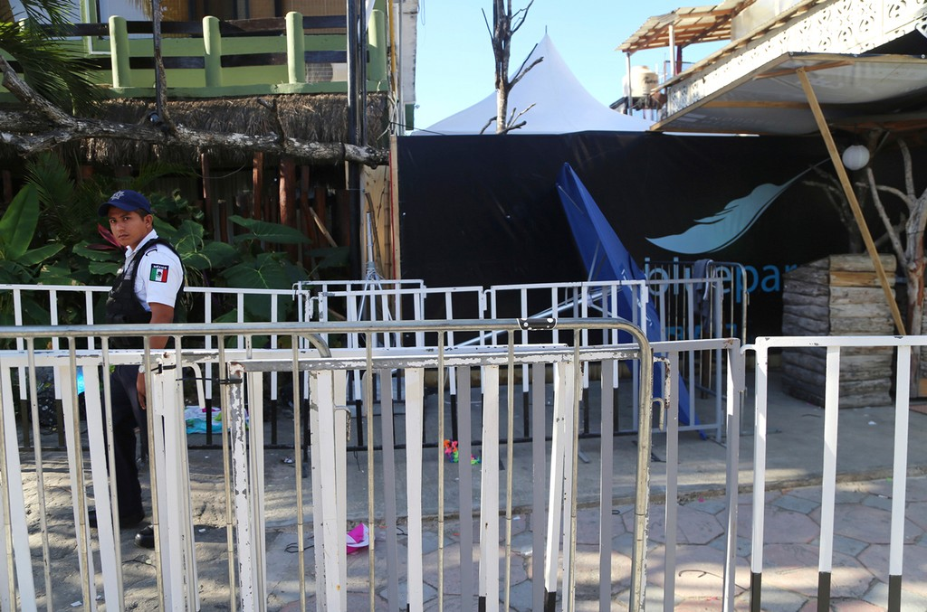 A police guard the entrance of the Blue Parrot nightclub, after a shooting in Playa del Carmen, Mexico on Jan. 16, 2017.