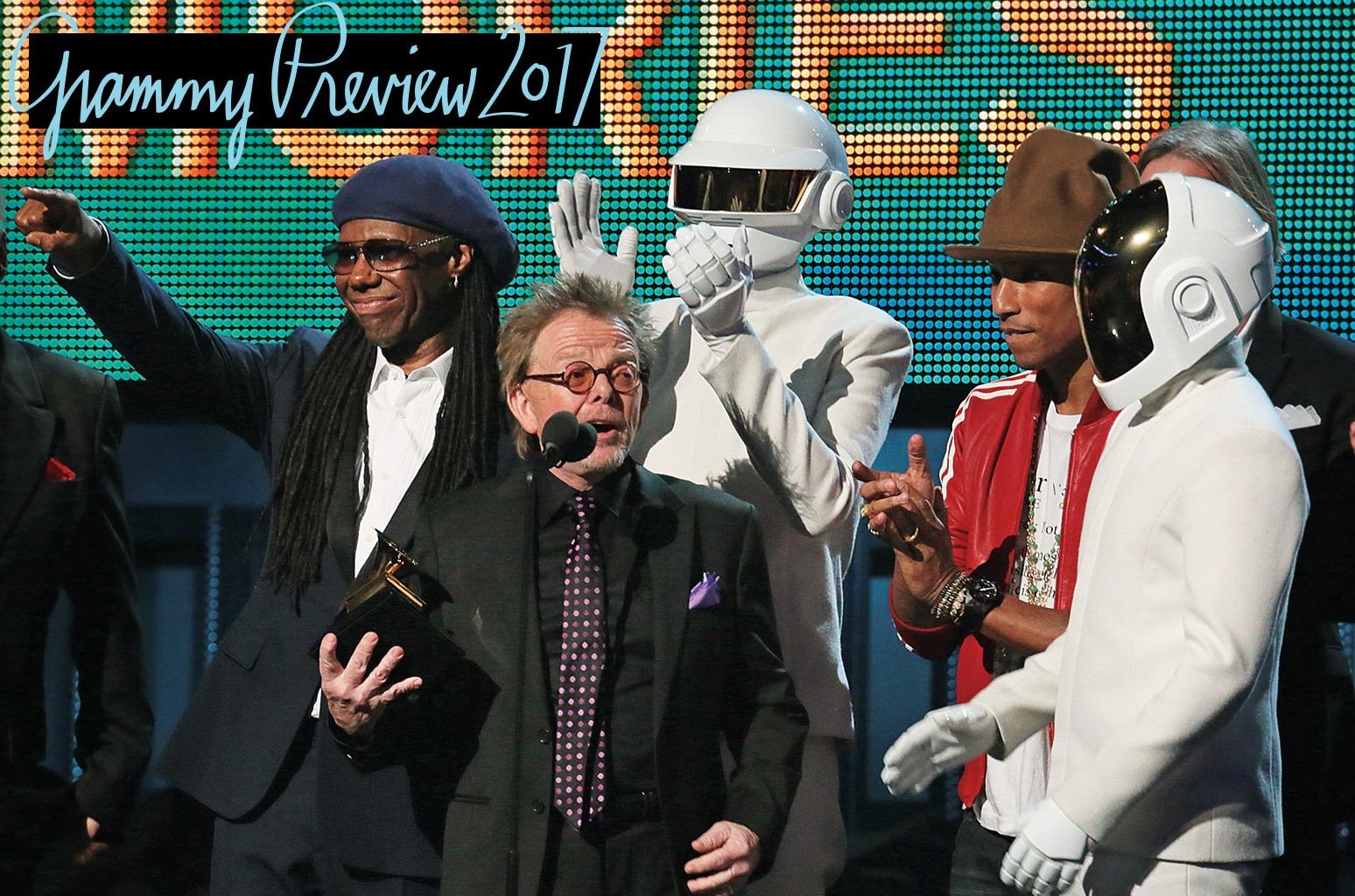 Williams (center) accepted the 2014 album of the year Grammy for Random Access Memories with (from left) Rodgers, Daft Punk and Pharrell Williams.