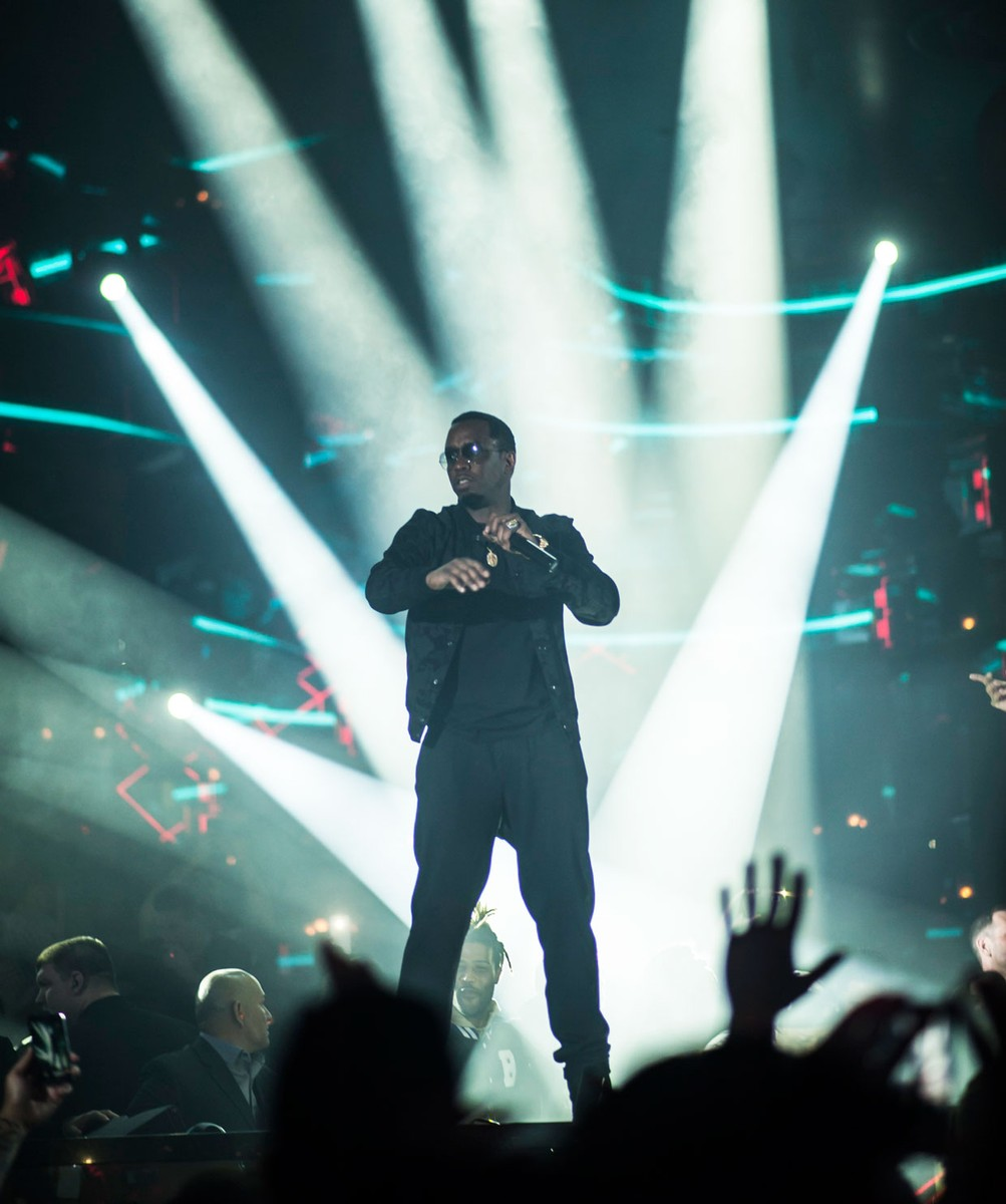Diddy jumps on stage at OMNIA Nightclub to host a dance off during Grand Opening Weekend.