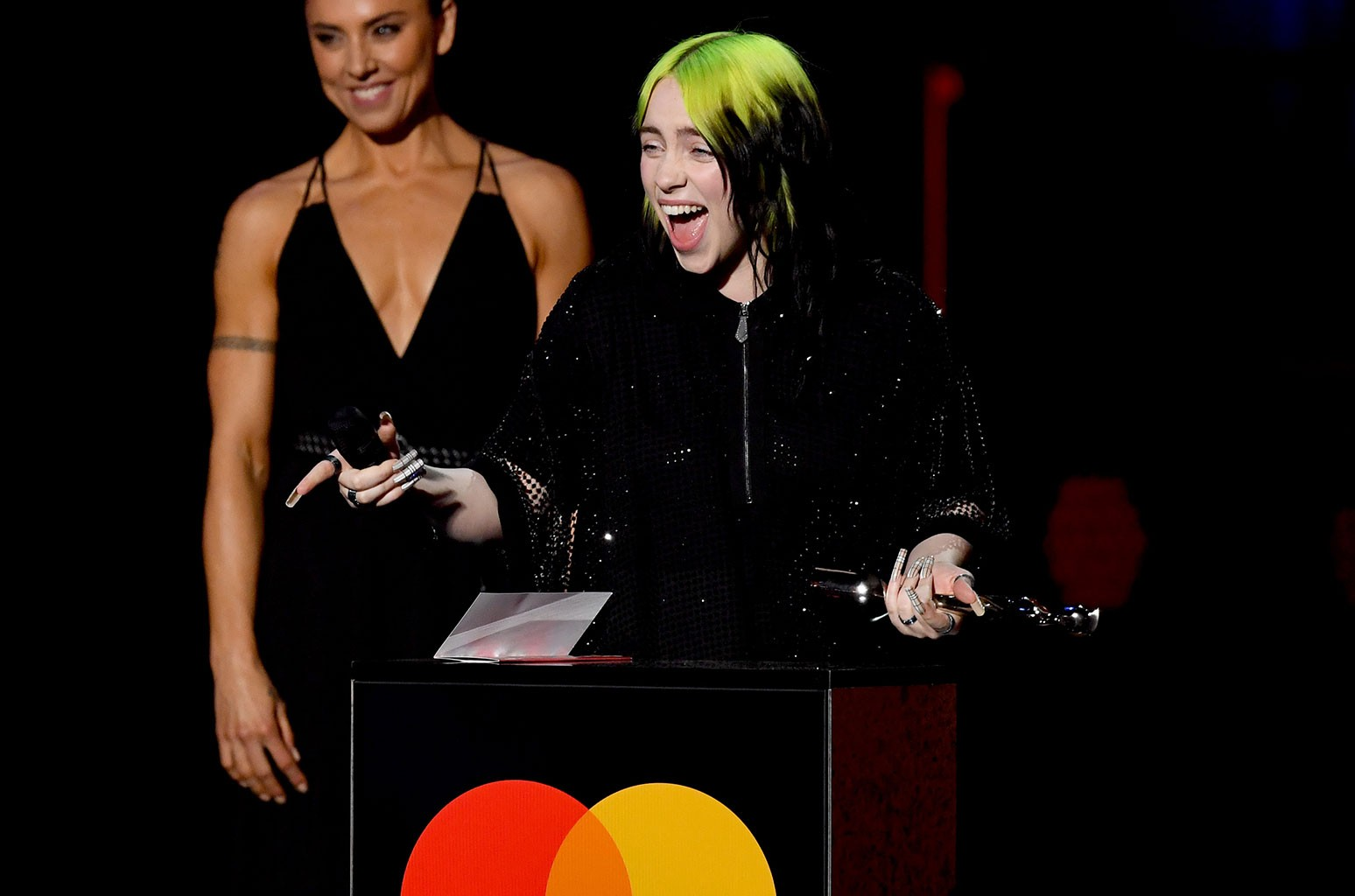 Billie Eilish Was So Excited To Win Her First Brit Award She Blurted Out Lizzo S Name Billboard