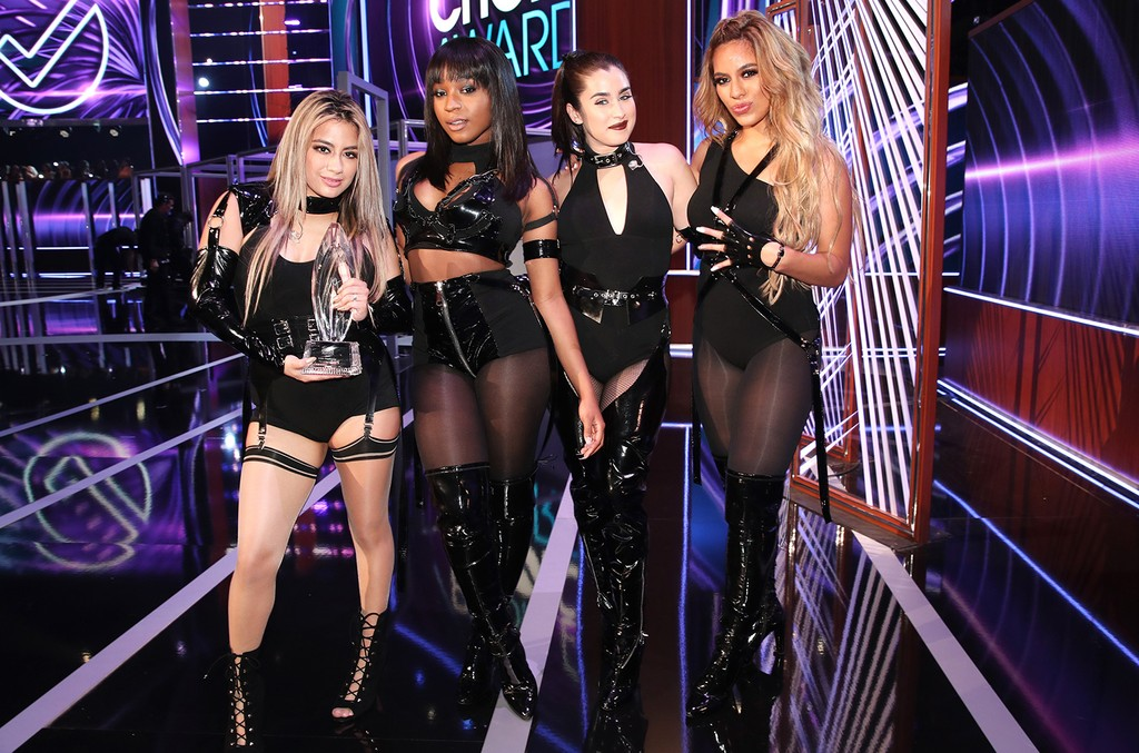 Ally Brooke, Normani Kordei, Lauren Jauregui, and Dinah Jane of music group Fifth Harmony, winners of the Favorite Group award, pose onstage during the People's Choice Awards 2017 at Microsoft Theater on Jan.18, 2017 in Los Angeles.
