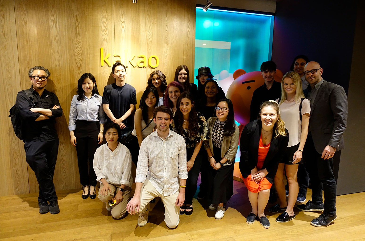 Bandier students post with Melon executives.