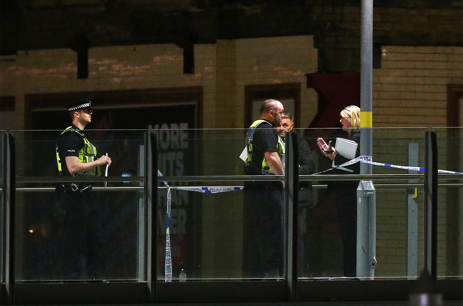 Police cordon off an area close to the Box Office entrance to the Manchester Arena on May 23, 2017 in Manchester, England.