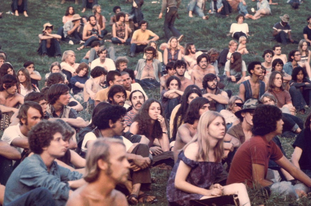 View of a portion of the audience as they watch a performance at the Woodstock Music and Arts Fair, Bethel, New York, August 1969.
