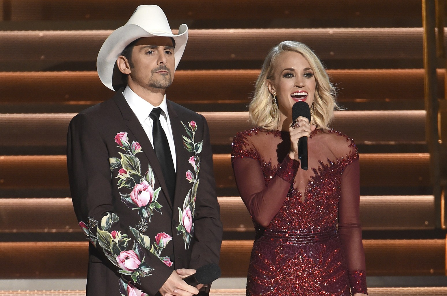Brad Paisley and Carrie Underwood speak at the 50th annual CMA Awards