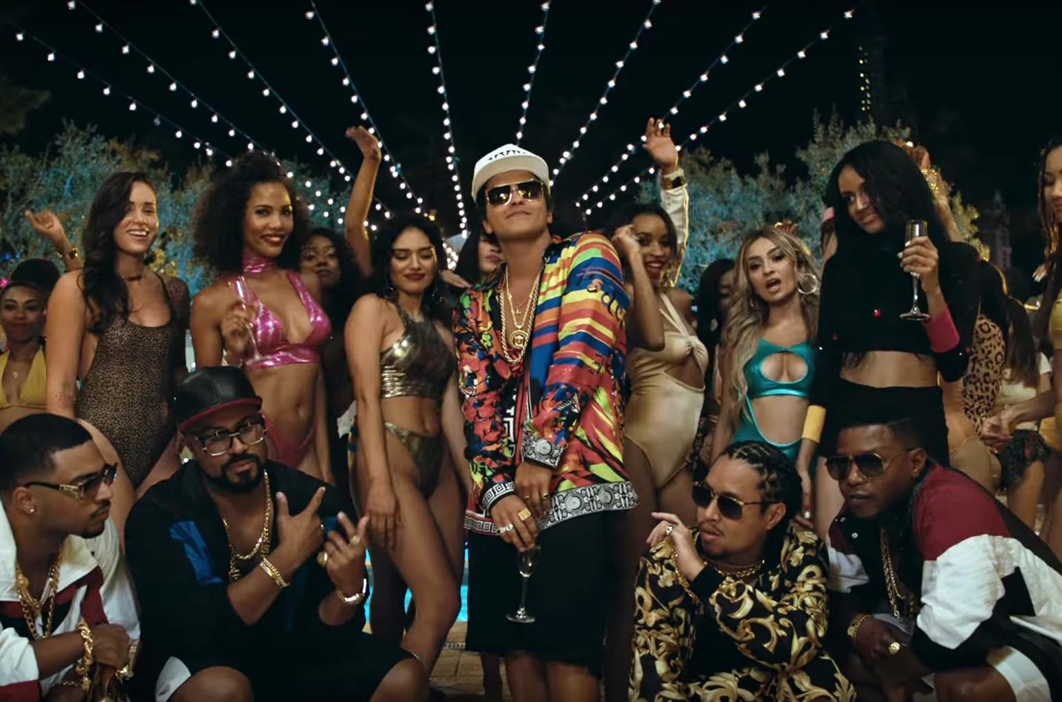 "Bruno Mars in the video for ""24K Magic."""