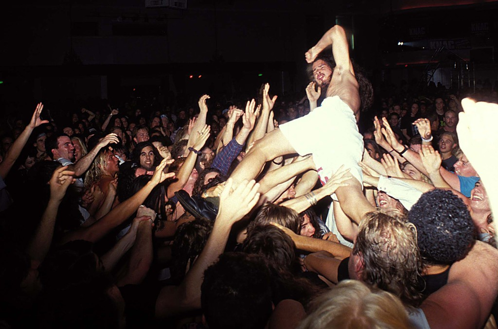 Chris Cornell crowd surfs during a performance with of Soundgarden.