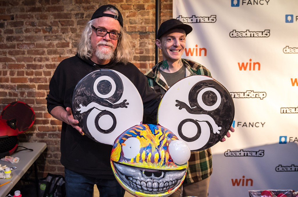 Artist Ron English and Deadmau5 poses with custom merchandise at the 'Lost of Stuff in a Store' Deadmau5 pop-up shop on March 31, 2017 in New York City.