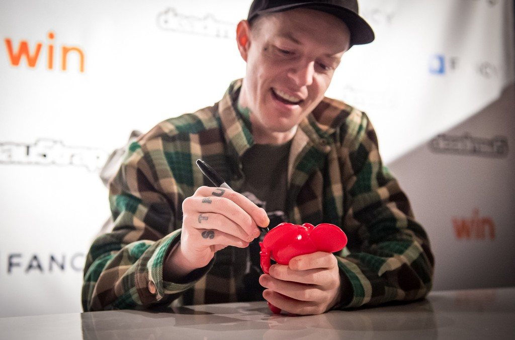 Deadmau5 signs merchandise at the 'Lost of Stuff in a Store' Deadmau5 pop-up shop on March 31, 2017 in New York City.