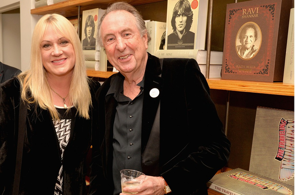 """Debbi Peterson of The Bangles (L) and comedian Eric Idle attend the """"I ME MINE"""" George Harrison book launch at Subliminal Projects Gallery on February 25, 2017 in Los Angeles, California.  (Photo by Jeff Kravitz/FilmMagic)"""