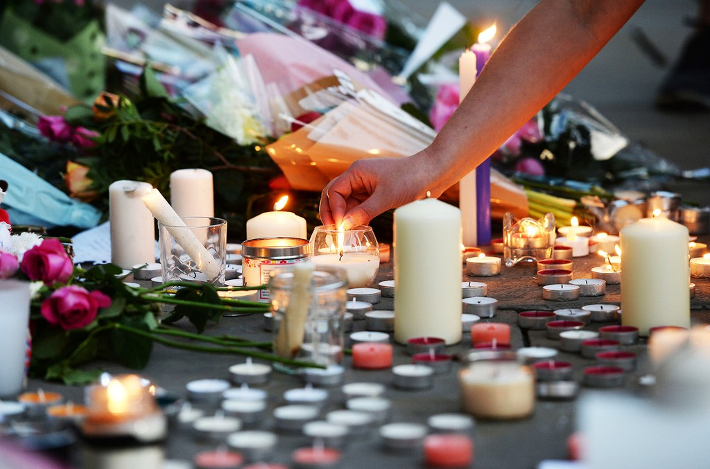 People leave tributes in Albert Square in Manchester, England on May 23, 2017.