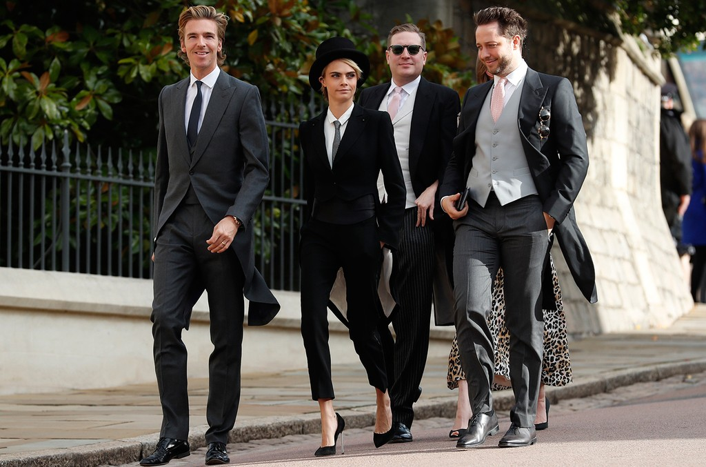 Cara Delevingne arrives with her brother-in-law James Cook (L) and US journalist Derek Blasberg