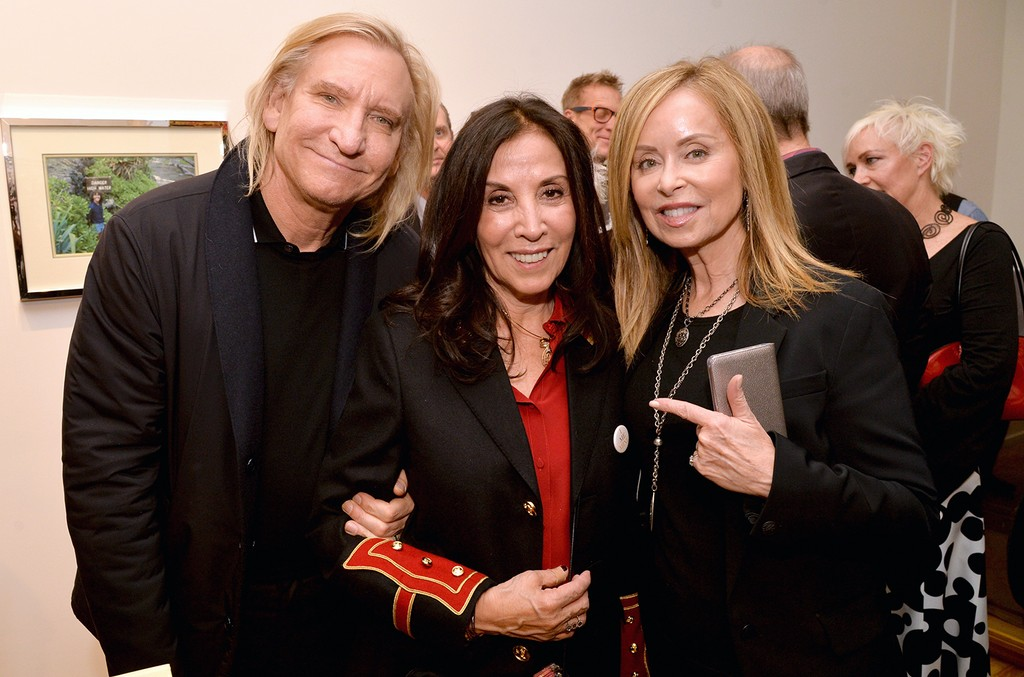 """Joe Walsh of The Eagles, Olivia Harrison and Marjorie Bach attend the """"I ME MINE"""" George Harrison book launch at Subliminal Projects Gallery on Feb. 25, 2017 in Los Angeles."""