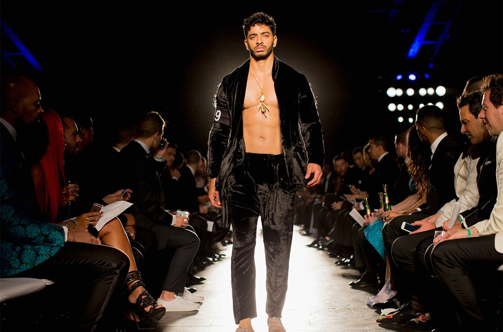Laith Ashley walks the runway during the 7th Annual amfAR Inspiration Gala New York at Skylight at Moynihan Station on June 9, 2016 in New York City.