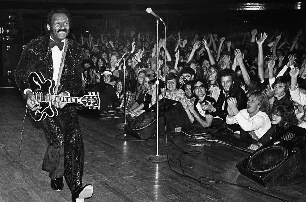"""Chuck Berry struts his signature """"duck walk"""" while playing his Gibson guitar during a 1980 concert at the Palladium in Hollywood, Calif."""