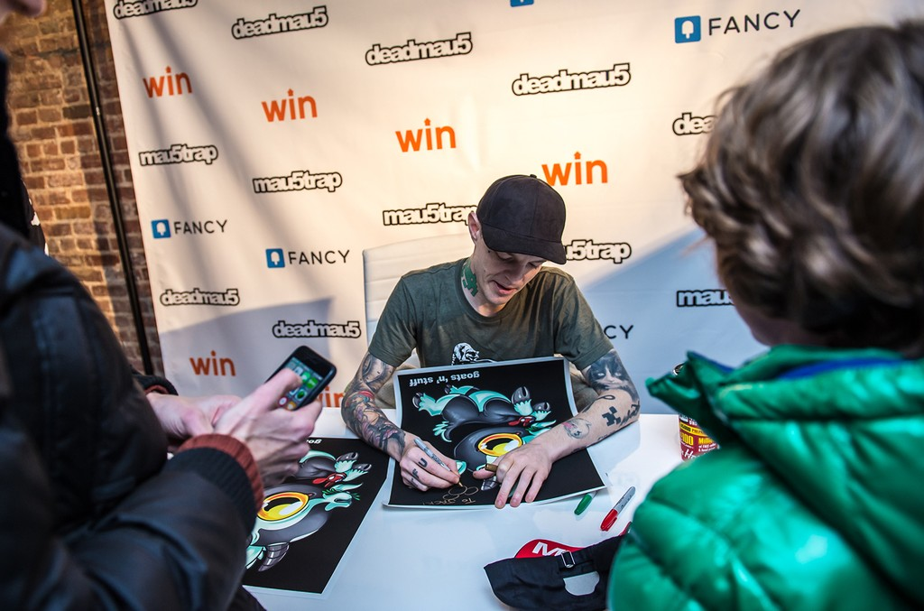 Deadmau5 signs posters at the 'Lost of Stuff in a Store' Deadmau5 pop-up shop on March 31, 2017 in New York City.