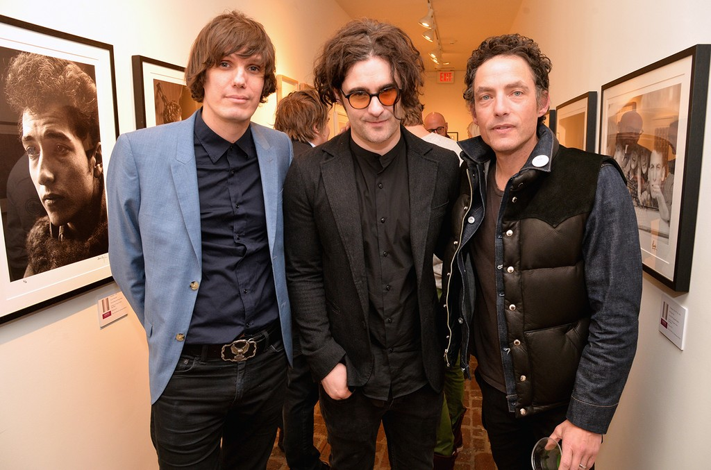 """Nikolai Fraiture of The Strokes, Robert Levon Been of Black Rebel Motorcyle Club and Jakob Dylan attend the """"I ME MINE"""" George Harrison book launch at Subliminal Projects Gallery on Feb. 25, 2017 in Los Angeles."""