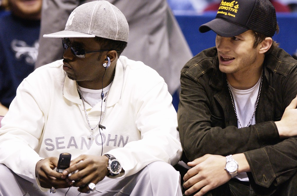 "Sean ""P. Diddy"" Combs and actor Ashton Kutcher sit courtside at the game between the Boston Celtics and the New Jersey Nets in Game two of the Eastern Conference Semifinals on May 7, 2003 at Continental Airlines Arena in East Rutherford, New Jersey."