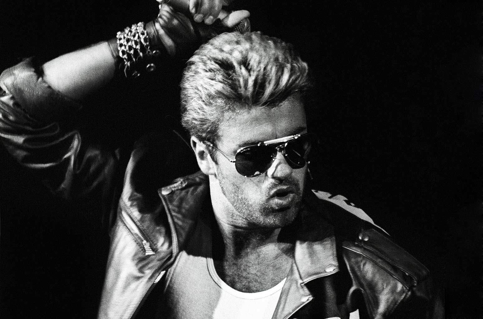 George Michael performs on stage during the Faith Tour in the Netherlands on April 12, 1988.