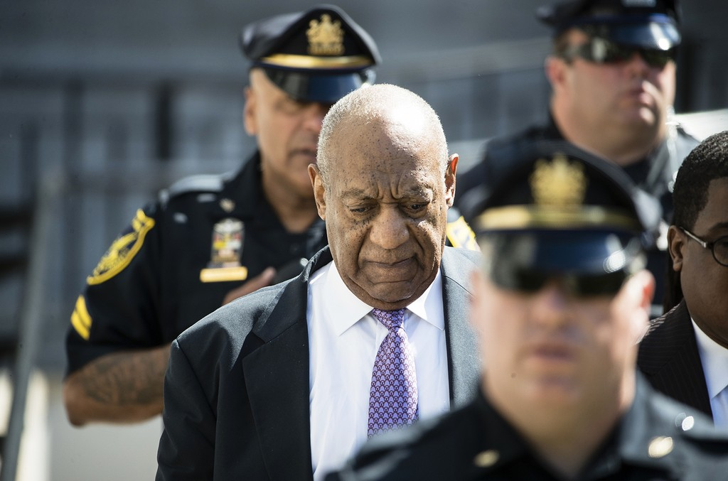 Bill Cosby walks from the Montgomery County Courthouse during his sexual assault trial in Norristown, Pa.