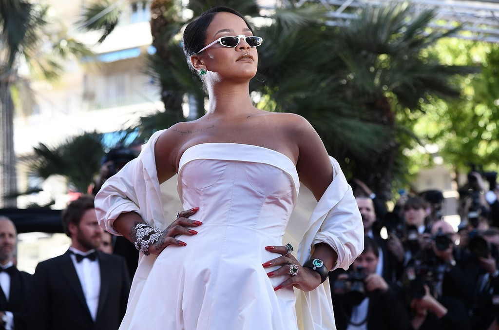 Rihanna poses as she arrives on May 19, 2017 for the screening of the film 'Okja' at the 70th edition of the Cannes Film Festival in Cannes.