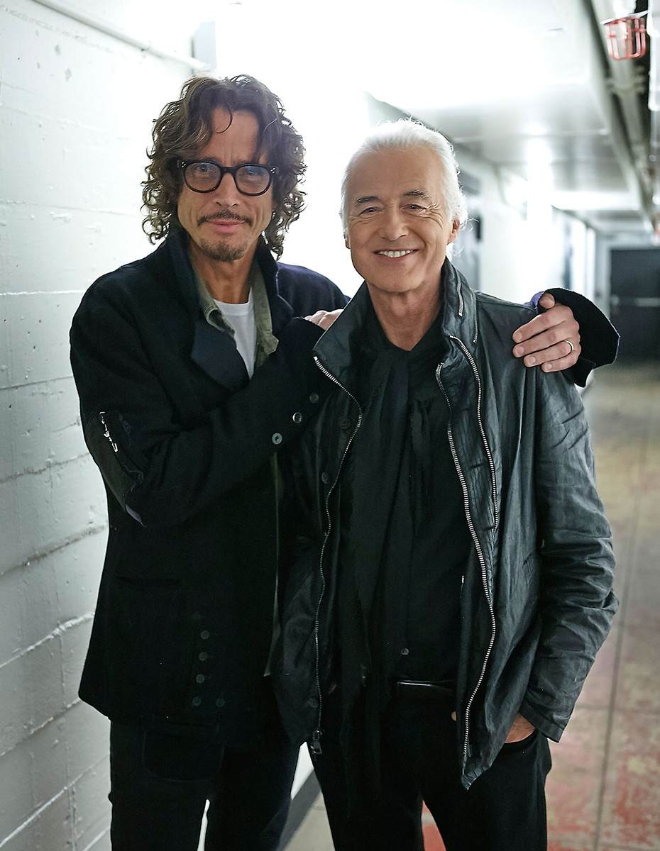 Chris Cornell and Jimmy Page pose back stage at An Evening With Jimmy Page And Chris Cornell In Conversation at Ace Hotel on Nov. 12, 2014 in Los Angeles.