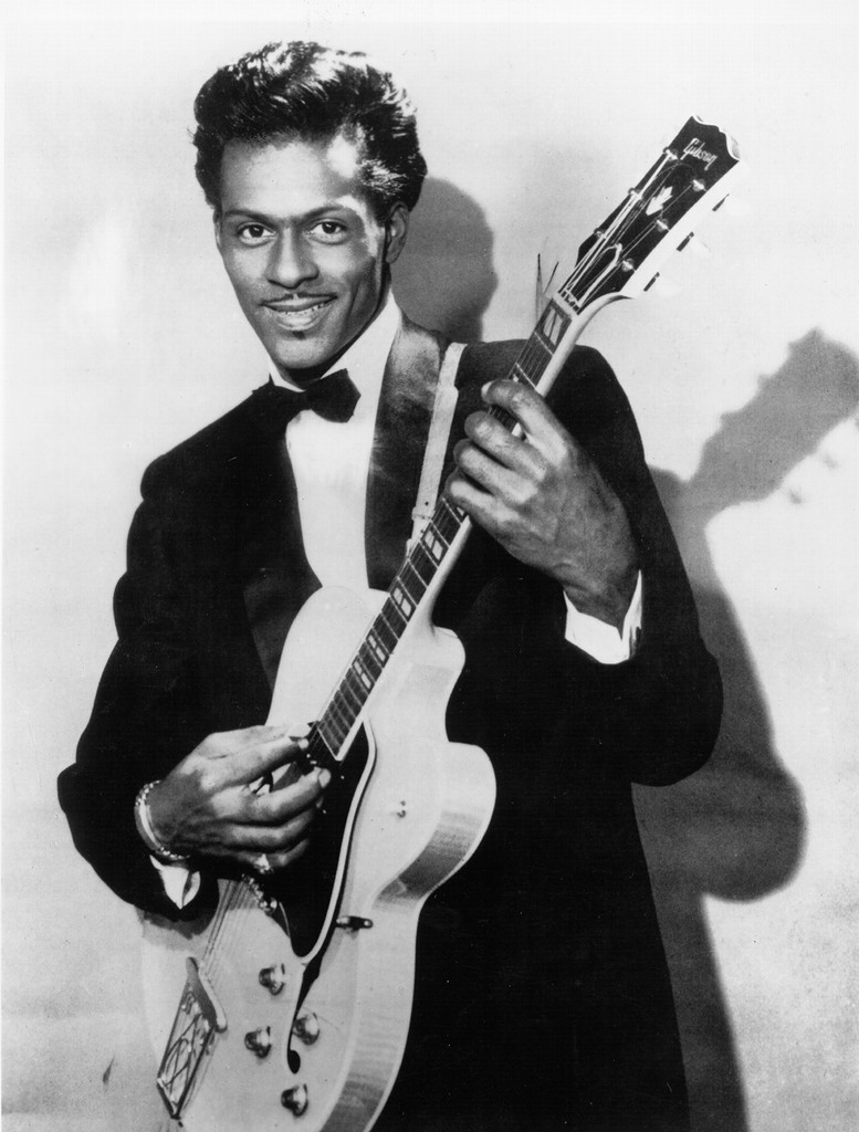 Chuck Berry poses for a portrait holding his Gibson hollowbody electric guitar circa 1958.