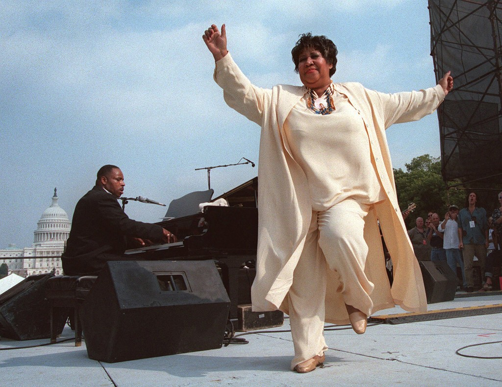 Aretha Franklin dances on stage during the first annual march on cancer Saturday, Sept. 26, 1998, in Washington.
