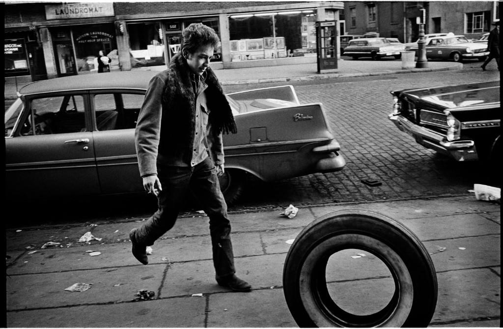 Bob Dylan rolling a tire, Greenwich Village, New York City, 1963