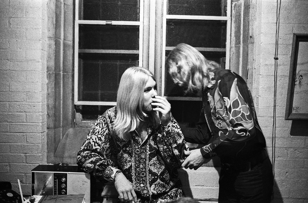 Duane Allman (R) chats with his brother Greg Allman (L) backstage before the Allman Brothers' performance at the Sitar on Oct. 17, 1970 in Spartanburg, South Carolina.
