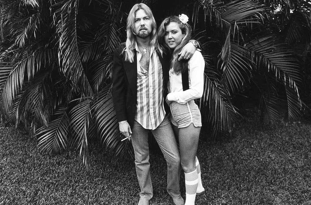 Gregg Allman and Julie Bidas, as they pose in the back yard of the Palm Beach Institute, West Palm Beach, Florida in 1979.