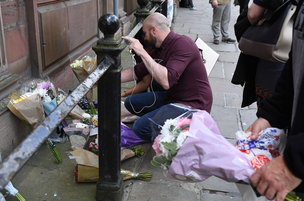 People leave flowers in St. Anne's Square on May 23, 2017 in Manchester, England.