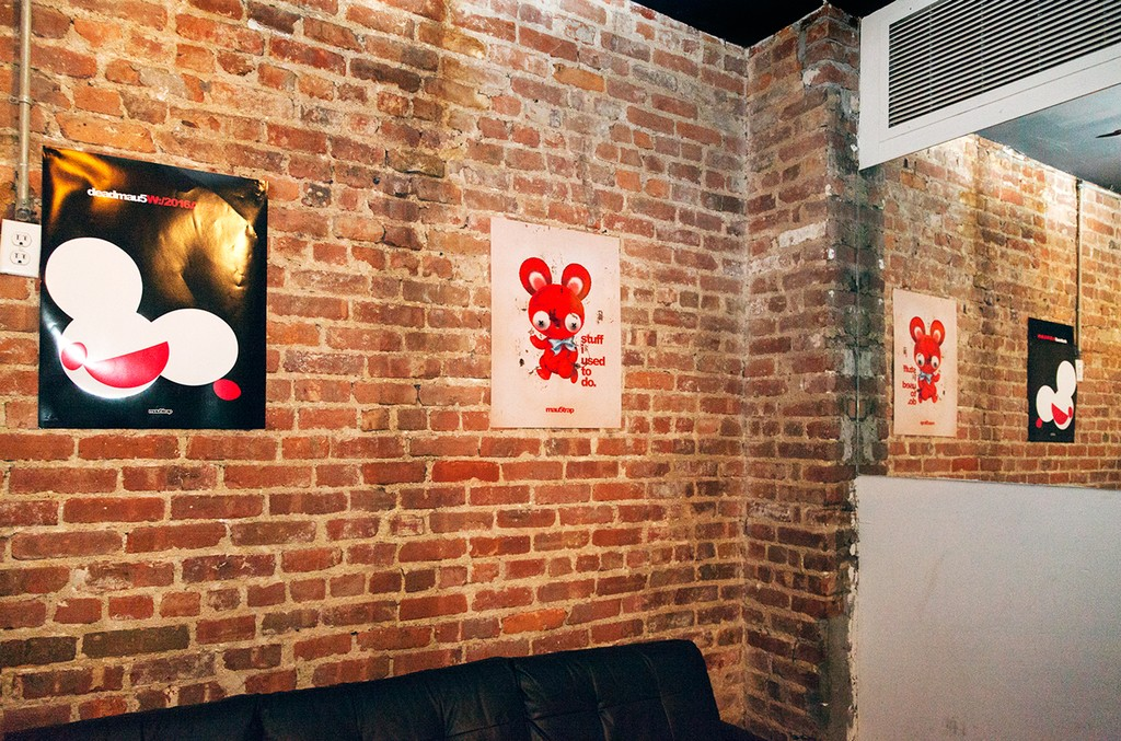Posters on the walls of the lounge area at the 'Lost of Stuff in a Store' Deadmau5 pop-up shop on March 31, 2017 in New York City.